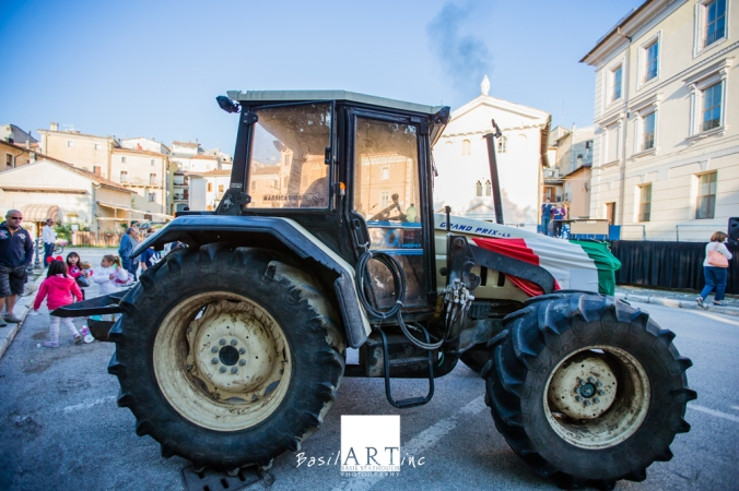 The demonstration in piazza: Flag draped over the tractor