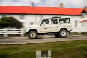 Landrovers racing through town